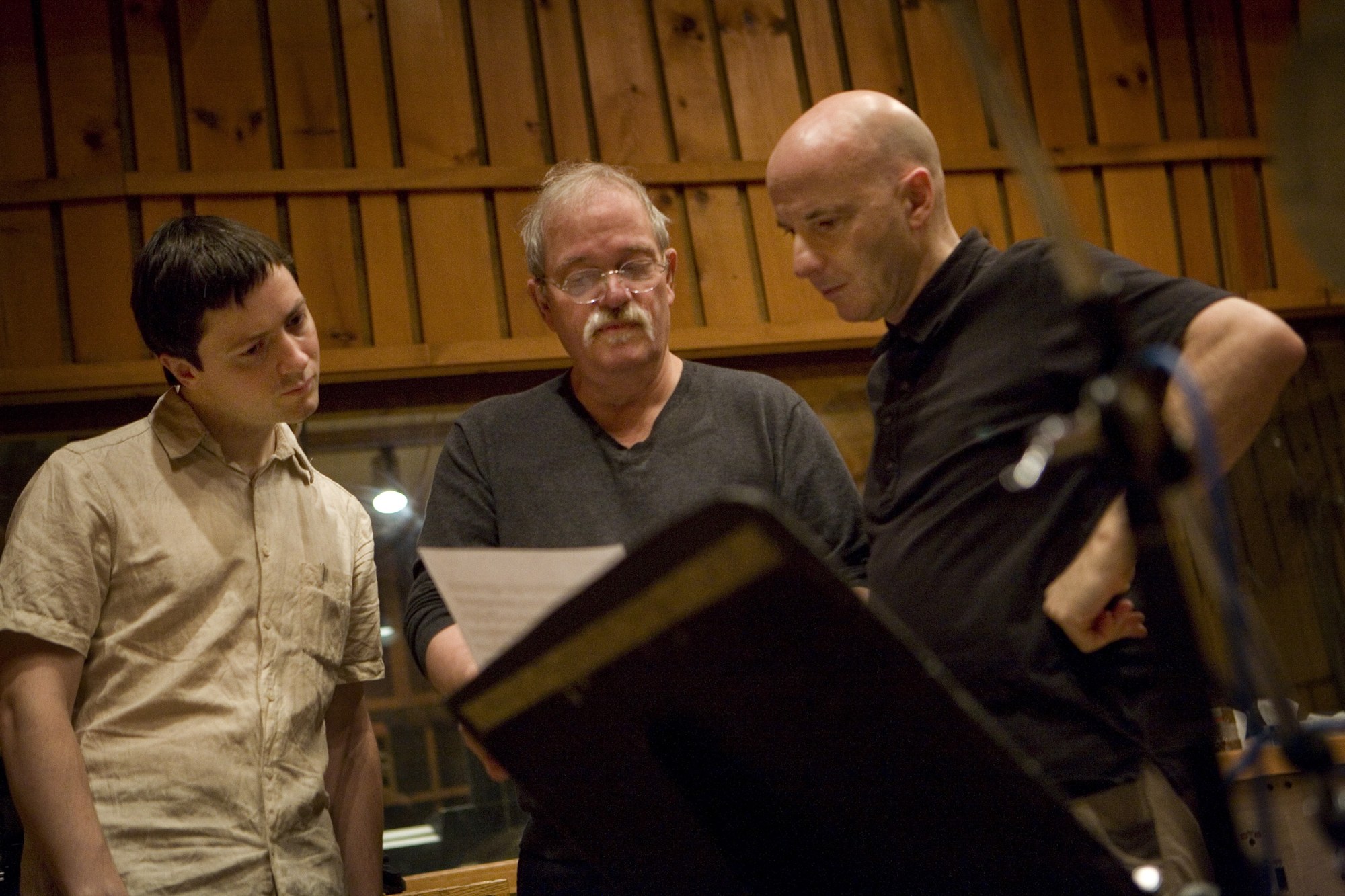 Thomas Morgan, John Abercrombie and Joey Baron looking over a score during the recording session for the 2009 album Wait Till You See Her (Photo © Robert Lewis, courtesy ECM).